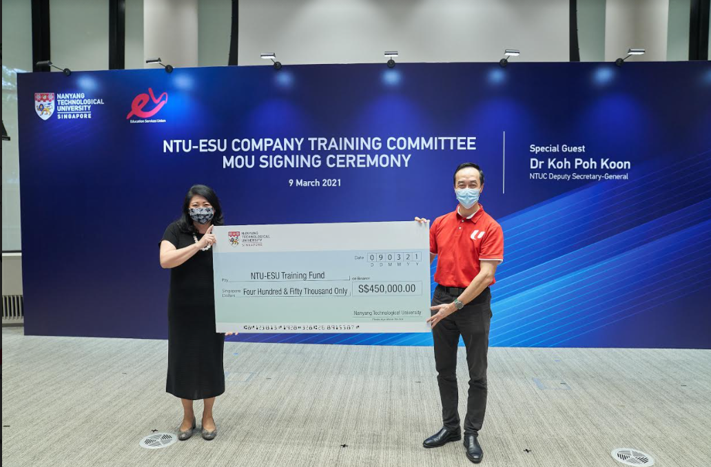 Ms Tan Aik Na, NTU Senior Vice President (Administration), presented a cheque to NTUC Deputy Secretary-General Dr Koh Poh Koon, signifying the University's contribution to the new training fund. (Credit: NTU)