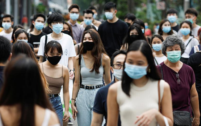 In total, Singapore reported 13 new COVID cases today. Photo courtesy: Reuters