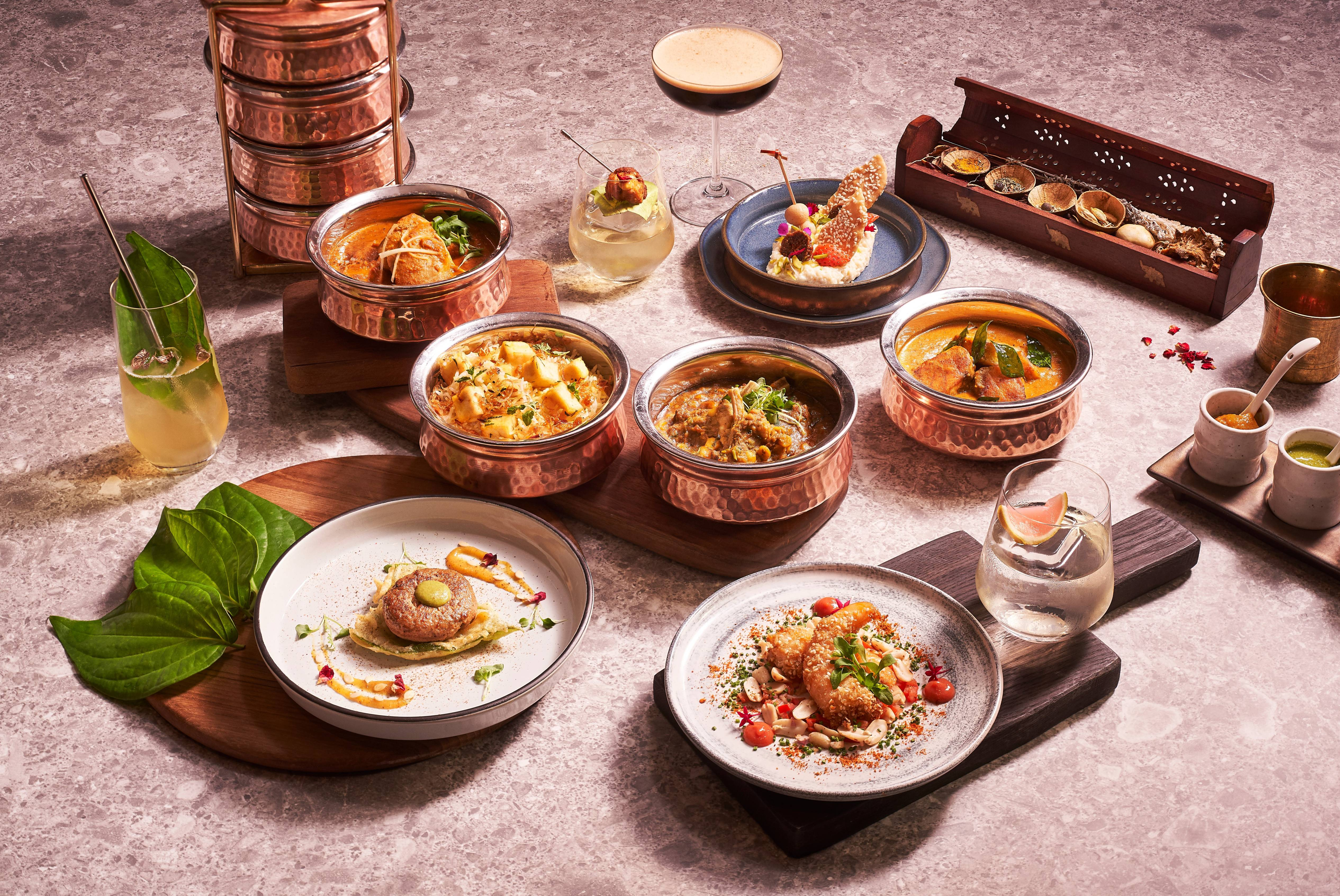The main course is a selection of familiar Tiffin Room dishes served in their signature tiffin containers