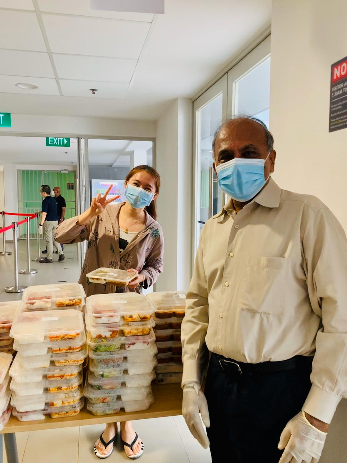 Prof Subra Suresh, NTU president, giving out food packs to students residing on campus during Singapore's circuit breaker period from April to June 2020. Photo courtesy: NTU